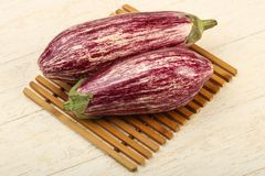 Fresh ripe eggplant. Over the wooden background Stock Image