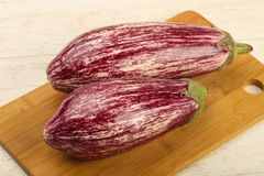 Fresh ripe eggplant. Over the wooden background Royalty Free Stock Photos