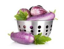 Fresh ripe eggplants in colander Royalty Free Stock Photo