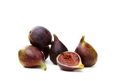 Fresh ripe figs and a juicy slice Stock Photography