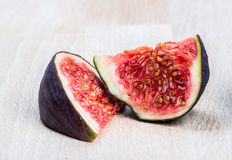 Fresh ripe figs on wood Royalty Free Stock Photo