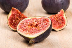 Fresh ripe figs on wood Stock Images