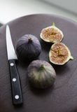 Fresh ripe figs on the wooden table Stock Images