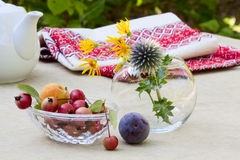Fresh ripe fruit and wild flowers Royalty Free Stock Images