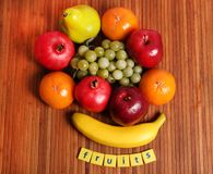 Fresh ripe fruits. Beautiful shot of fresh fruits with wooden background stock images