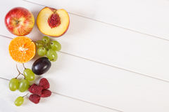 Fresh ripe fruits on white boards, healthy nutrition, copy space for text. Fresh ripe fruits on white boards, healthy lifestyle and nutrition, copy space for Stock Photo