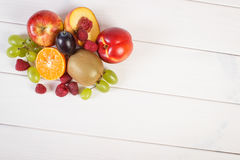Fresh ripe fruits on white boards, healthy nutrition, copy space for text. Fresh ripe fruits on white boards, healthy lifestyle and nutrition, copy space for Stock Photos