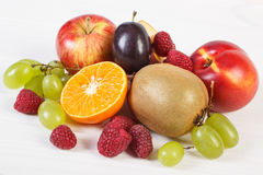 Fresh ripe fruits on white boards, healthy nutrition Stock Photos