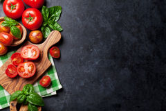 Fresh ripe garden tomatoes and basil Royalty Free Stock Photography