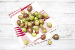 Fresh ripe gooseberries on folded cloth napkin Royalty Free Stock Photography