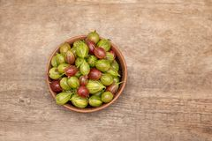 Fresh ripe gooseberry on a wooden background.  stock photography