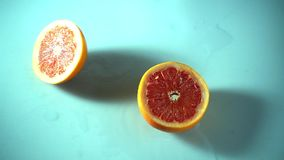 Fresh ripe grapefruits fall on the table, super slow motion hd video stock video