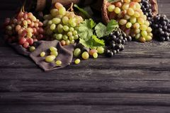 Fresh ripe grapes on table. Fresh ripe grapes on wooden table Stock Photo