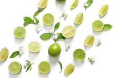 Fresh ripe green limes on white background, top view. Composition with fresh ripe limes on white background, top view royalty free stock photo