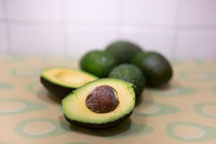 Fresh ripe halved avocado pear Stock Images