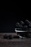 Fresh Ripe Juicy Blackberries in a plate on black background.  Royalty Free Stock Image