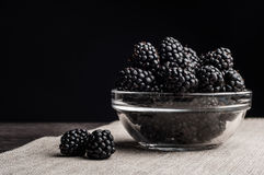 Fresh Ripe Juicy Blackberries in a plate on black background.  Stock Photography
