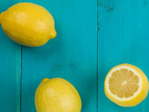 Fresh Ripe Juicy Citrus Lemons. Against a Blue Wooden Background royalty free stock photography