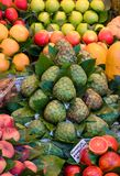 Fresh fruits and vegetables, market stall, food background. Fresh ripe juicy fruits and vegetables at a local la Boqueria market in Barcelona, Spain stock photography