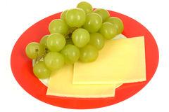 Fresh Ripe Juicy Grapes and Cheese Slices Healthy Vegetarian Snack. On a plate isolated white background Royalty Free Stock Image