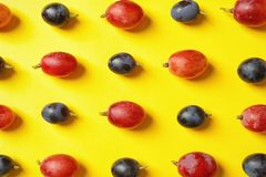 Fresh ripe juicy grapes on yellow background. Top view stock images