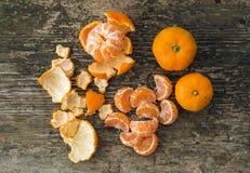 Fresh ripe juicy mandarins on rough wood background Stock Images