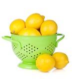 Fresh ripe lemons in colander Royalty Free Stock Photos