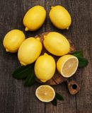 Fresh ripe lemons. On a old wooden table Stock Photos