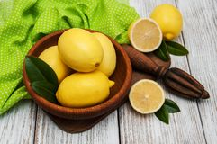 Fresh ripe lemons. On a old wooden table Royalty Free Stock Image
