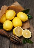 Fresh ripe lemons. On a old wooden table Royalty Free Stock Photo