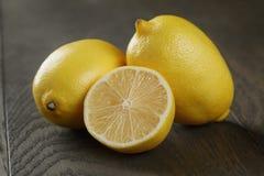 Fresh ripe lemons on old oak table Royalty Free Stock Photo