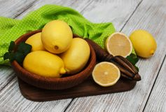 Fresh ripe lemons. On a old wooden table Royalty Free Stock Photography