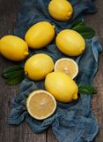 Fresh ripe lemons. On a old wooden table Royalty Free Stock Photos