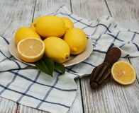 Fresh ripe lemons. On a old wooden table Stock Images