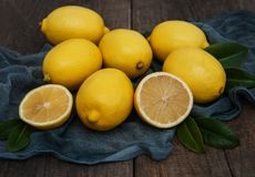 Fresh ripe lemons. On a old wooden table Royalty Free Stock Images