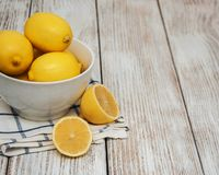 Fresh ripe lemons. On a old wooden table Stock Photo