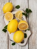 Fresh ripe lemons. On a old wooden table Stock Photography