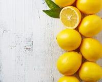 Fresh ripe lemons on wooden table Stock Images