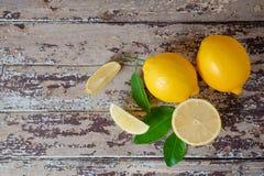 Fresh ripe lemons on wooden table. Top view Stock Image