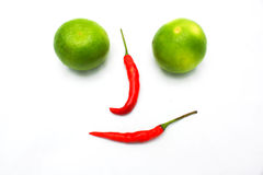 Fresh ripe lime and red hot chili pepper Stock Image