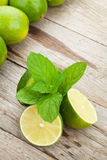 Fresh ripe limes with mint Stock Photography