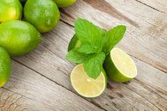 Fresh ripe limes with mint Stock Photos