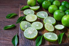 Fresh ripe limes on wooden background stock photo