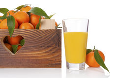 Fresh ripe mandarines in wooden crate. Stock Photo