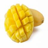 Fresh Ripe Mangoes. One and a half golden mango fruits, isolated on white background Stock Image