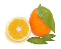 Fresh ripe orange fruits with cut and green leaves isolated Stock Images