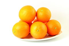 Fresh ripe orange fruits in plate in white background Royalty Free Stock Image