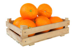 Fresh and ripe orange fruits in a wooden crate isolated on white Stock Photo