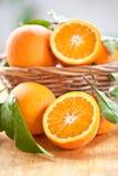 Fresh ripe oranges. In a vintage basket royalty free stock photos
