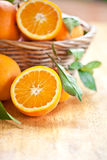 Fresh ripe oranges. In a vintage basket Royalty Free Stock Photos